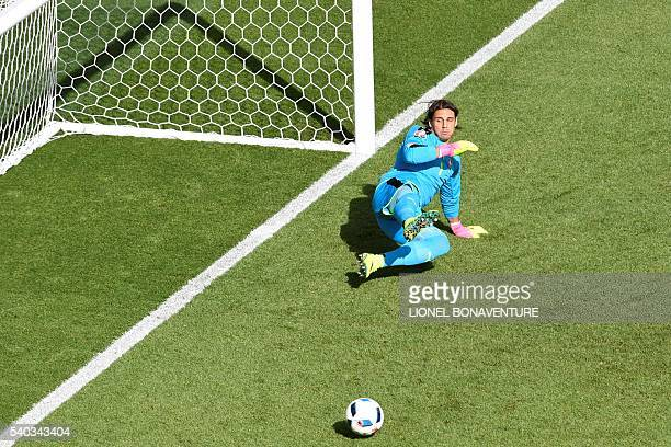 Switzerland's goalkeeper Yann Sommer looks on after Romania's forward Bogdan Stancu scored a penalty during the Euro 2016 group A football match...