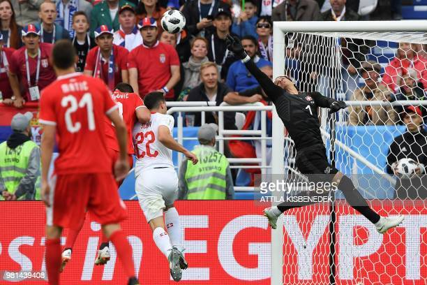 Switzerland's goalkeeper Yann Sommer makes a save during their Russia 2018 World Cup Group E football match between Serbia and Switzerland at the...