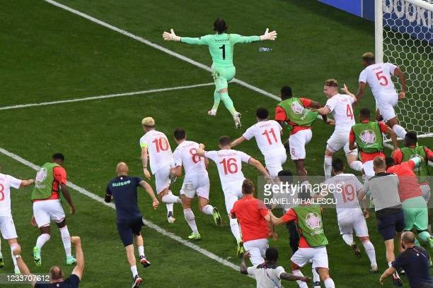 Switzerland's goalkeeper Yann Sommer reacts after saving a shot by France's forward Kylian Mbappe in the penalty shootout during the UEFA EURO 2020...