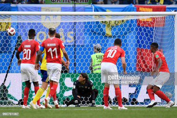 Switzerland's goalkeeper Yann Sommer reacts as Sweden score a goal during the Russia 2018 World Cup round of 16 football match between Sweden and...