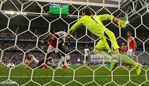 Switzerland's goalkeeper Yann Sommer runs for the ball as Switzerland's defender Johan Djourou vies with France's midfielder Moussa Sissoko and...