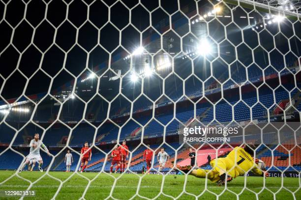 Switzerland's goalkeeper Yann Sommer saves a penalty kicked by Spain's defender Sergio Ramos during the UEFA Nations League football match between...