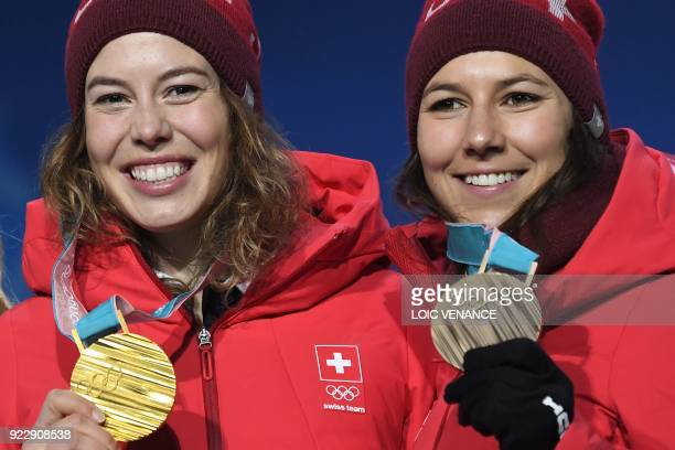 TOPSHOT Switzerland's gold medallist Michelle Gisin and Switzerland's bronze medallist Wendy Holdener pose on the podium during the medal ceremony...