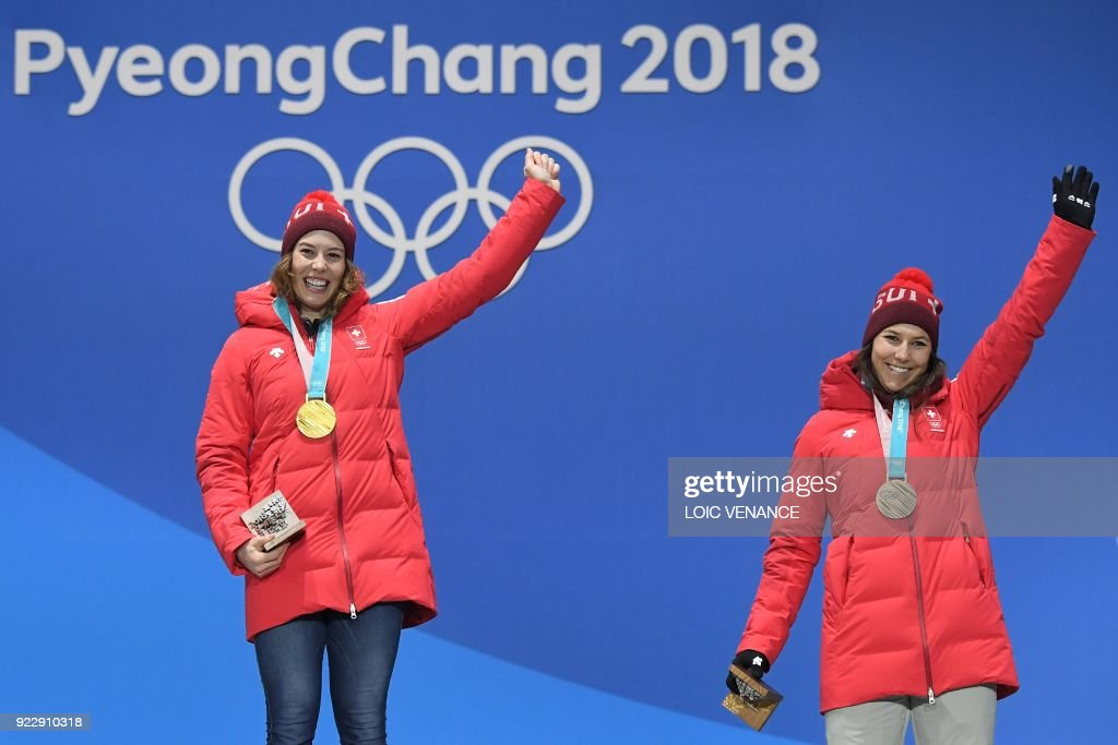 Switzerland's gold medallist Michelle Gisin (L) and Switzerland's bronze medallist Wendy Holdener pose on the podium during the medal ceremony for the alpine skiing women's combined at the Pyeongchang Medals Plaza during the Pyeongchang 2018 Winter Olympic Games in Pyeongchang on February 22, 2018. /