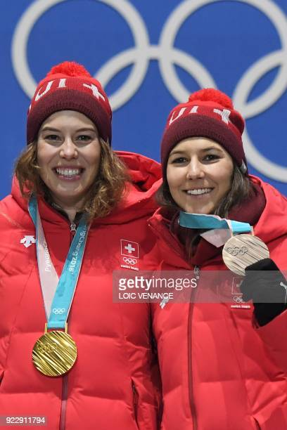 Switzerland's gold medallist Michelle Gisin and Switzerland's bronze medallist Wendy Holdener pose on the podium during the medal ceremony for the...