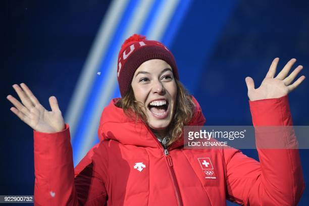 TOPSHOT Switzerland's gold medallist Michelle Gisin celebrates on the podium during the medal ceremony for the alpine skiing women's combined at the...