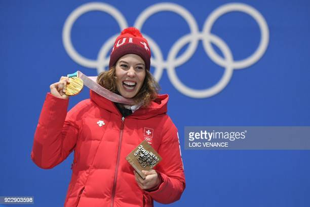 Switzerland's gold medallist Michelle Gisin poses on the podium during the medal ceremony for the alpine skiing women's combined at the Pyeongchang...