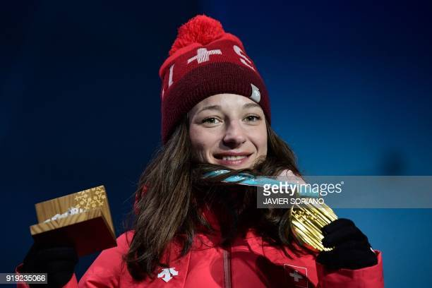 Switzerland's gold medallist Sarah Hoefflin poses on the podium during the medal ceremony for the freestyle skiing women's ski slopestyle at the...