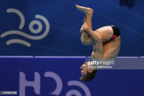 Switzerland's Guillaume Dutoit competes in the preliminary for the Men's 1m Springboard Diving event during the LEN European Aquatics Championships...