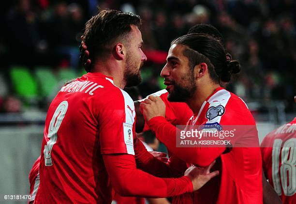 Switzerland's Haris Seferovic and Ricardo Rodriguez celebarate a goal during a WC 2018 football qualification match Hungary v Switzerland in Budapest...