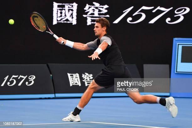 Switzerland's Henri Laaksonen hits a return against Australia's Alex de Minaur during their men's singles match on day three of the Australian Open...