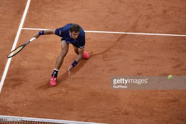 Switzerland's Henri Laaksonen plays against Serbia's Novak Djokovic during their men's singles second round match on day five of The Roland Garros...