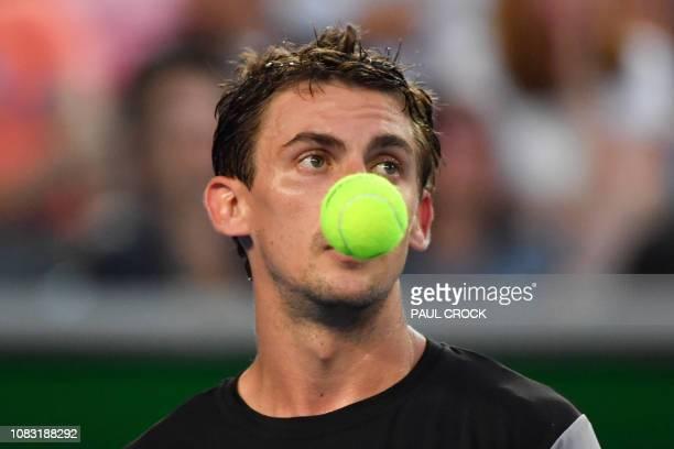 Switzerland's Henri Laaksonen reacts after a point against Australia's Alex de Minaur during their men's singles match on day three of the Australian...