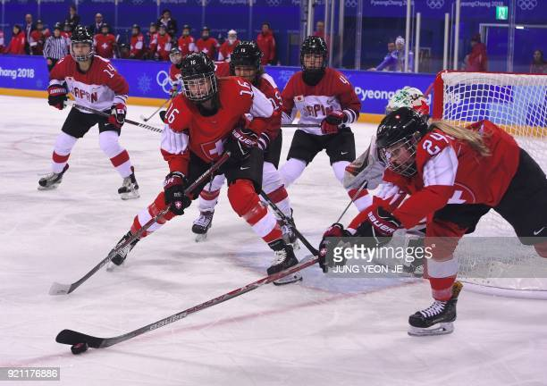 TOPSHOT Switzerland's Isabel Waidacher controls the puck in the women's playoff classifications ice hockey match between Switzerland and Japan during...