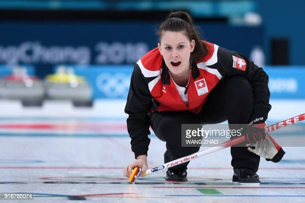 Switzerland's Jenny Perret shouts instructions to her teammate during the curling mixed doubles round robin session between Switzerland and the...