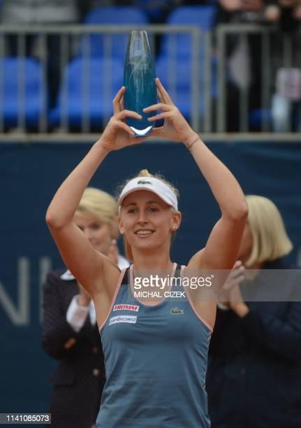 Switzerland's Jil Teichmann poses with her trophy after winning over Czech Republic's Karolina Muchova their final match at the WTA Prague tennis...