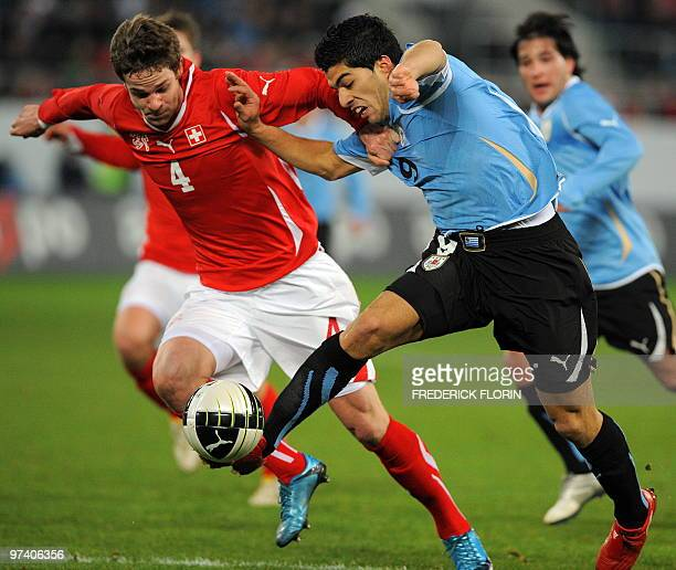 Switzerland's Jonathan Rossini vies with Uruguay's Luis Suarez during the World Cup 2010 friendly football match Switzerland vs Uruguay at AFG Arena...