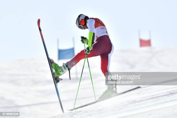 Switzerland's Justin Murisier stops competing in the Men's Giant Slalom at the Jeongseon Alpine Center during the Pyeongchang 2018 Winter Olympic...