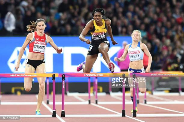 TOPSHOT Switzerland's Léa Sprunger Jamaica's Ristananna Tracey and Britain's Meghan Beesley compete in a semifinal of the women's 400m hurdles...