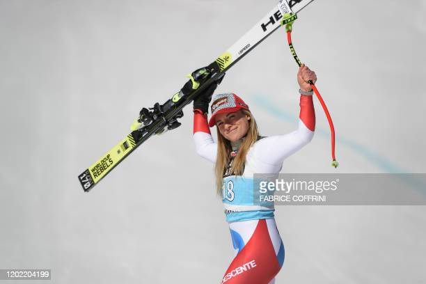 Switzerland's Lara GutBehrami celebrates during the podium ceremony after winning in the Women's downhill race during the FIS Alpine Ski World Cup in...