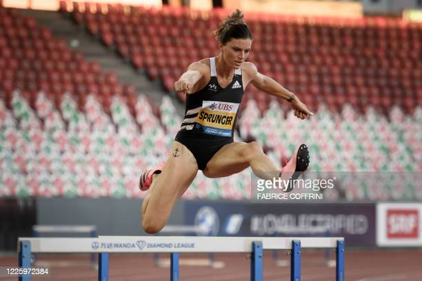 Switzerland's Lea Sprunger competes in the women's 300m hurdles during the Inspiration Games exhibition event being held remotely across different...