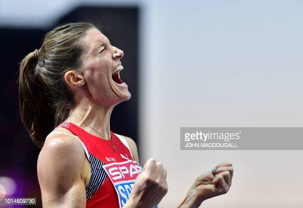 Switzerland's Lea Sprunger reacts after winning the women's 400m Hurdles final race during the European Athletics Championships at the Olympic...