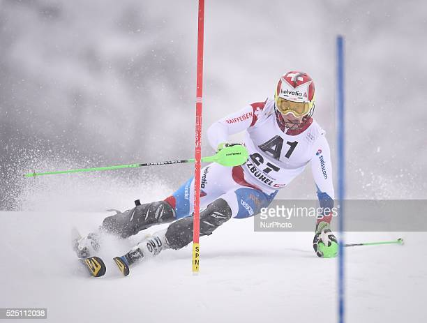 Switzerland's Luca Aerni races down the course during the men's Slalom on the third day of the famous Hahnenkamm at the FIS SKI World Cup in...
