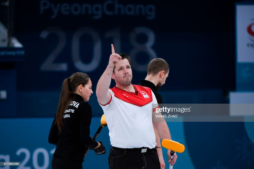 Switzerland's Martin Rios celebrates after winning the curling mixed doubles semi-final during the Pyeongchang 2018 Winter Olympic Games at the Gangneung Curling Centre in Gangneung on February 12, 2018. / AFP PHOTO / WANG Zhao