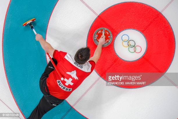TOPSHOT Switzerland's Martin Rios competes during the curling mixed doubles round robin session between Switzerland and South Korea during the...
