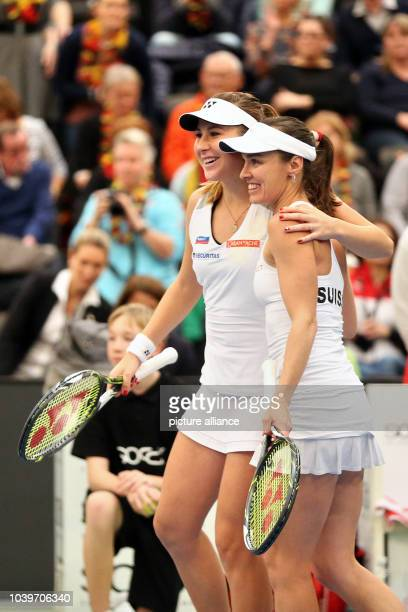 Switzerland's Martina Hingis and Belinda Bencic celebrating after their win against Germany's Petkovic and Groenefeld at the Fed Cup tennis...