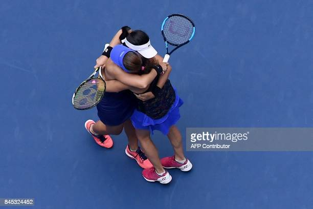 Switzerland's Martina Hingis embraces her partner Taipei's YungJan Chan after winning their 2017 US Open Women's Doubles final match at the USTA...