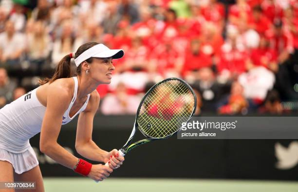 Switzerland's Martina Hingis in action with teammate Belinda Bencic during their match against Andrea Petkovic and AnnaLena Groenefeld of Germany at...
