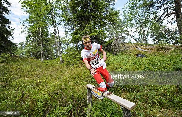 Switzerland's Matthias Kyburz competes to finish fourth in the men's middle distance final in the IOF World Orienteering Championships 2013 in...