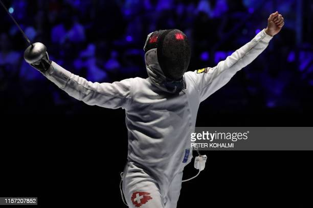 Switzerland's Max Heinzer reacts at the end of the Men's Epee team event for the third place at the 2019 Fencing World Championships in Budapest...