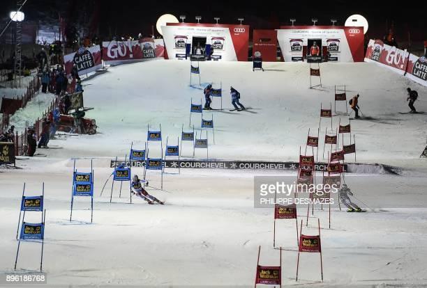 Switzerland's Melanie Meillard and Austria's Ricarda Haaser compete during the FIS Alpine World Cup Women's Parallel Slalom on December 20 2017 in...