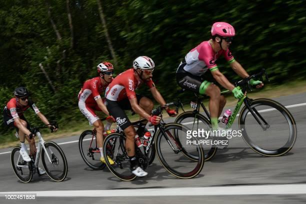 Switzerland's Michael Schar Belgium's Dimitri Claeys Belgium's Thomas De Gendt and New Zealand's Tom Scully ride during their breakaway in the 13th...
