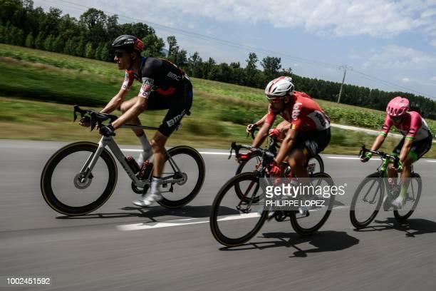 Switzerland's Michael Schar Belgium's Thomas De Gendt Belgium's Dimitri Claeys and New Zealand's Tom Scully ride during their breakaway in the 13th...