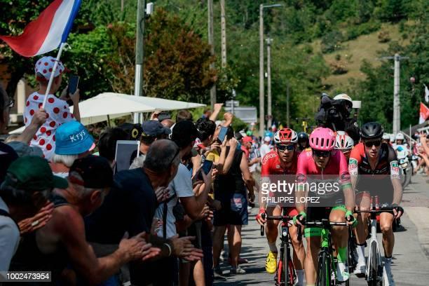 Switzerland's Michael Schar Belgium's Thomas De Gendt New Zealand's Tom Scully and Belgium's Dimitri Claeys ride during their breakaway in the 13th...