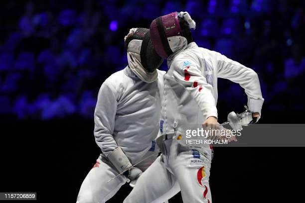 Switzerland's Michele Niggerler and China's Lan Minghao compete in the Men's Epee team event for the third place at the 2019 Fencing World...