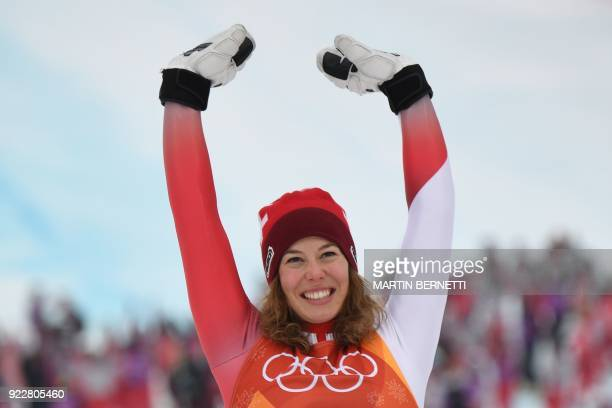 TOPSHOT Switzerland's Michelle Gisin gold celebrates during the victory ceremony of the Women's Alpine Combined Slalom at the Jeongseon Alpine Center...