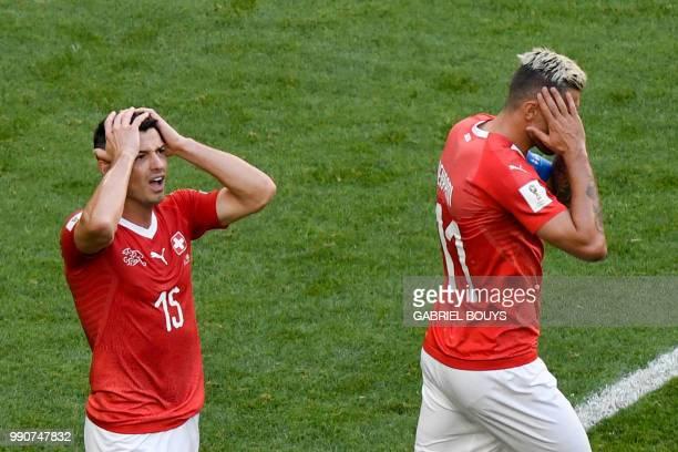 Switzerland's midfielder Blerim Dzemaili and Switzerland's midfielder Valon Behrami react during the Russia 2018 World Cup round of 16 football match...