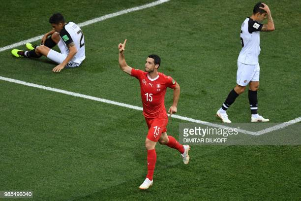 TOPSHOT Switzerland's midfielder Blerim Dzemaili celebrates after scoring the opening goal during the Russia 2018 World Cup Group E football match...