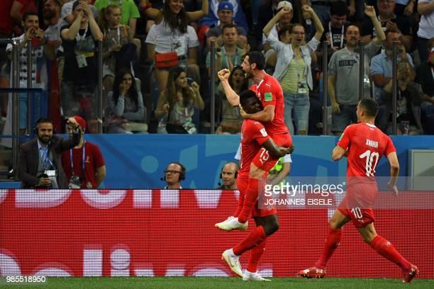 TOPSHOT Switzerland's midfielder Blerim Dzemaili celebrates with Switzerland's forward Breel Embolo after scoring the opening goal during the Russia...