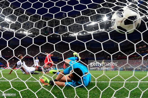 TOPSHOT Switzerland's midfielder Blerim Dzemaili reacts as he scores the opening goal past Costa Rica's goalkeeper Keylor Navas during the Russia...