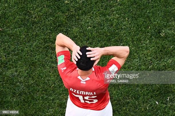 Switzerland's midfielder Blerim Dzemaili reacts during the Russia 2018 World Cup round of 16 football match between Sweden and Switzerland at the...