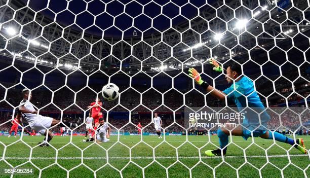 TOPSHOT Switzerland's midfielder Blerim Dzemaili shoots and scores the opening goal past Costa Rica's goalkeeper Keylor Navas during the Russia 2018...