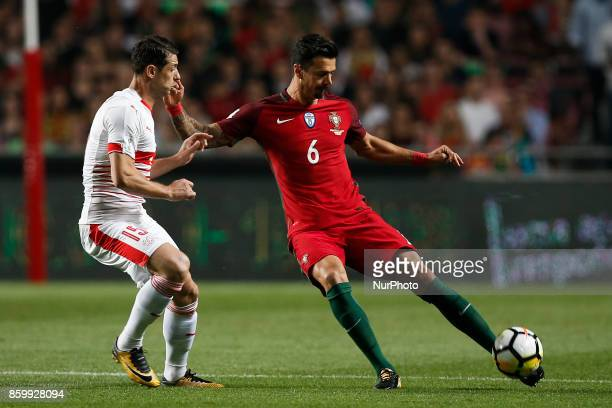 Switzerland's midfielder Blerim Dzemaili vies for the ball with Portugal's defender Jose Fonte during the FIFA World Cup WC 2018 football qualifier...