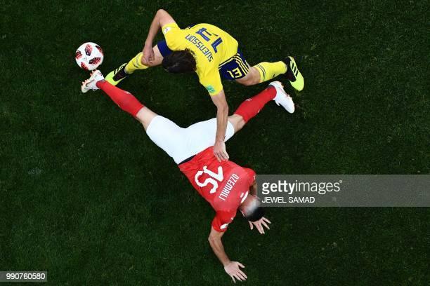 Switzerland's midfielder Blerim Dzemaili vies with Sweden's midfielder Gustav Svensson during the Russia 2018 World Cup round of 16 football match...