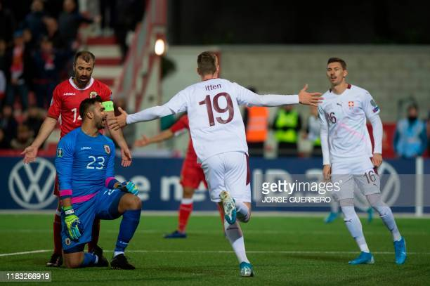 Switzerland's midfielder Cedric Itten celebrates after scoring a goal during the Euro 2020 Group D qualification football match between Gibraltar and...