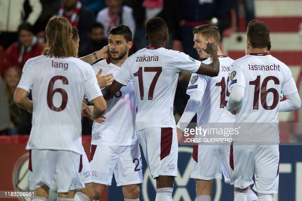 Switzerland's midfielder Cedric Itten celebrates with teammates after scoring a goal during the Euro 2020 Group D qualification football match...